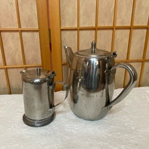 Stainless Steel Pitcher And A Creamer